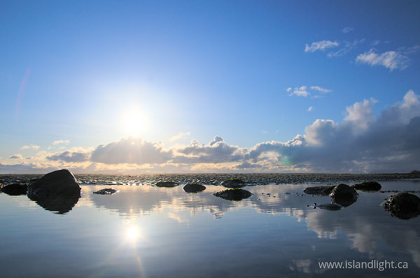 Summer Sky reflected in Tide-pool  - Cortes Island  photo