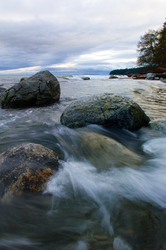 Wave Over Stones -   photo