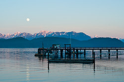 Rising Moon Over Squirrel Cove Dock - Cortes Island Harbour photo